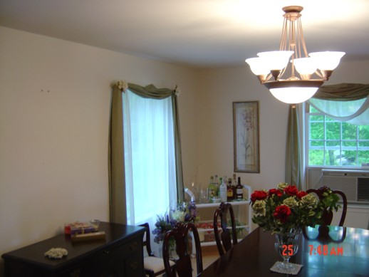 A dining room before the walls are painted.